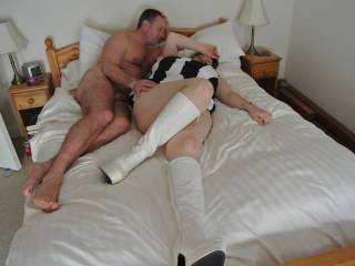 Now that's my kind of fun!  Sexy lady, bed, hubby watching...