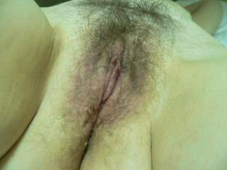 That is a sexy little pussy I would love to spread it open and lick on that clit