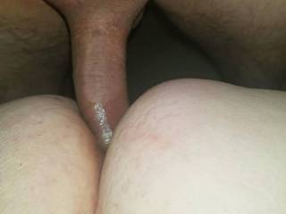 Fucking her ass and fingering her clit. Makes her cum hard