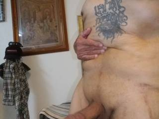Holding my beer belly to see my hard cock is anyone  needing a suck or fuck? I know I do
