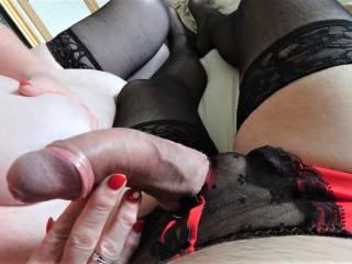Getting a handjob in panties and stockings