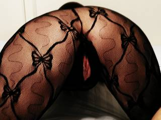 Wicked hot shot. I'd be happy feel those lace wrapped legs clasping tight around my waist pulling my cock deeper into that pretty, wet, eager pussy.