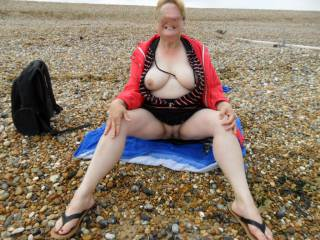 hi all me from the past flashing my body on the beach,  dirty comments welcome mature couple