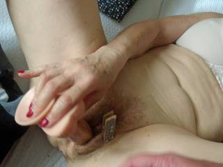 Wife fucking her pussy with a dildo