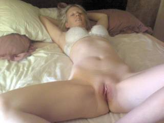 Wife spreading shaved pussy