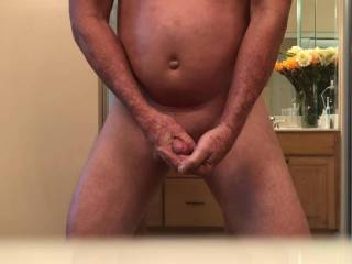 Me masturbating and cumming in my hand with a glass butt plug in my ass