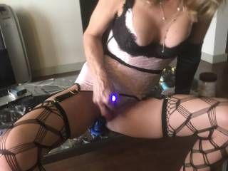 This is my sexy wife in a hot ass outfit riding a big vibrating dildo attached to coffee table while playing with another vibrator on clit