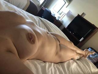 Just relaxing after a round of fun, tits sagging. Completely relaxed