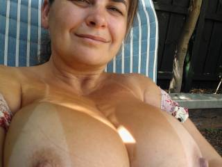 the tan lines look great on your wonderful tits! thx for being incredibly feminine! i feel like kising & licking my screen now...
