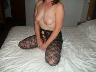 Striking pose, those hot tits held up high for use....I'd love to give those hot nipples a good soaking