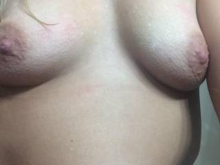 Showing her tits