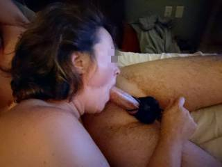 Taking me in her throat while she pulls my balls