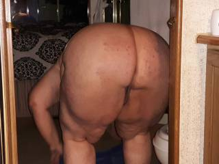 My girlfriend bending over showing me that sexy ass I\'m fixing to eat, anyone else want to eat it!