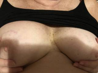 Telling me to play with and suck her nice mature tits.