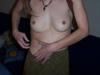I love her tits, they are not small at all.