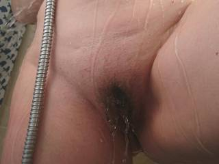 Wife under shower a Tuesday afternoon