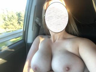 My big tits are out again on the highway, who wants to suck them?