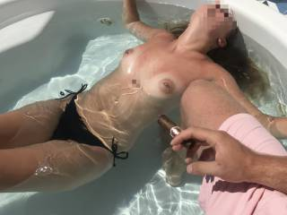 Tits out sunbathing in the hot tub