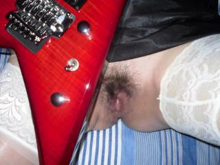 nice rockin guitar.and ofcourse pussy also.music goes great with sex.dont u agree?