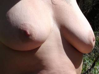 Another shot of my girlfriend\'s beautiful tits in the great outdoors. It was a warm day and those gorgeous nipples were pretty relaxed or soft. She wants to hear your comments on her tits and or nipples, so what do you think???