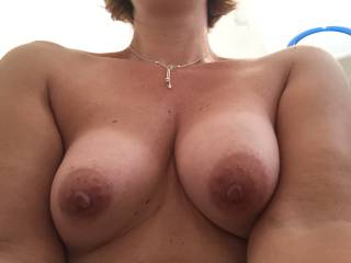 Outstanding tits! Would love to rub my fat cock all over them...