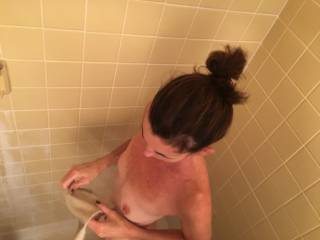 Showering after a great fuck. I love those tits and nipples. Would like to see someone cum all over them!