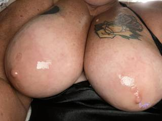 All oiled up so warm and slippery, who has some fat cock to slide in and out of these big naturals and cum on them?