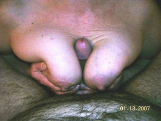 Stroking cock with my boobs, he fit great. The head of his cock is just starting to turn purple.