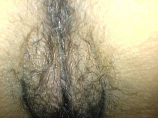 Here is a closeup of my wifes hairy latina snatch. I bet you can almost taste the spiciness!