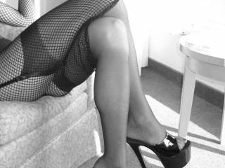 Suave, sophisticated, elegant and seriously sexy as fuck! I want to start with those peeping toes and oh so slowly work my way up...Stunning! :)