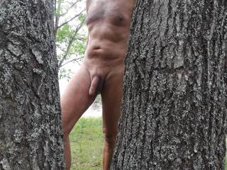 Naked at the cottage, going for a walk along the lake.