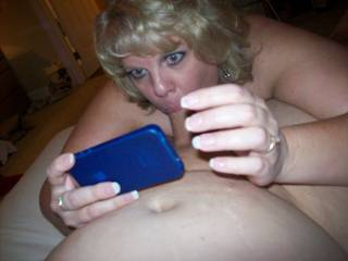 Mrs Daytonohfun taking a picture of her sucking my cock to send to her hubby while he was out of town.  He texted back for her to suck harder on me