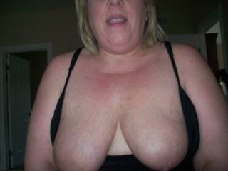 Mrs Dayton smiling and showing off her tits.  What you can\'t see is that she was sitting on my cock and fucking me!!!