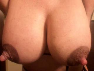 Your big natural 36DD tits have my cock rock hard. I'd enjoy every second your hard nipples were in my mouth as you rode my cock like a Texas cowgirl.