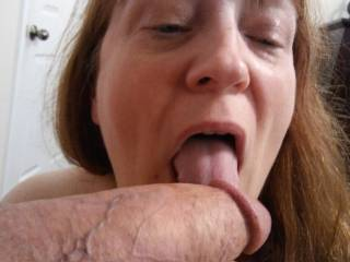 I might as well start at the tip of Hubby\'s luscious, thick and juicy cock, and work my way up that lovely engorged shaft of his. Mmm... I love sucking cock!