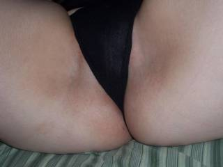 close up of thin fabric of her thong covering her sexy lips.