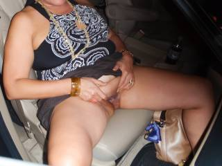 Sitting in the car taking some pussy flashing photos in a parking garage.