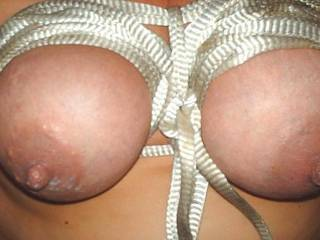 rope tite on tits turns me on lots...she sure has beautiful breasts....