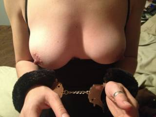I will leave you in those cuffs as i such on your tits and my fingers rubbing you under the skirt til you are so juicy and begging to be fucked...l am i helping? ;)