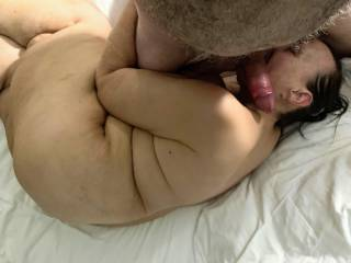 Curled up getting her face fucked with a vibe on her clit.