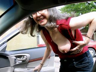 My husband came to pick me up. He had 2 buddies in the back seat of the car so I flashed my tit at them. Do you like my big, dark nipple?