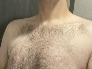 Showing off the chest hair. Just about time for a trim.