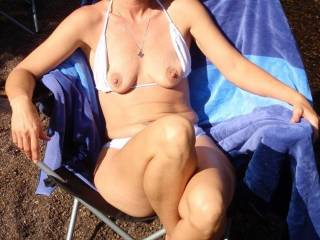 Sitting in the river flashing her great tits love to see a cum tribute