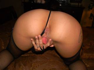Bending over and spreading that wet pussy