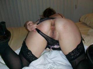 My fat wife loves modeling her hairy, chubby pussy in lingerie.