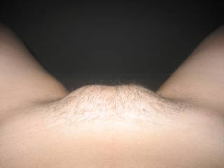 I love a womans pussy mound.  Yours makes not onlly my cock hard but my tongue as well.