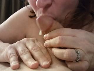 My cock sucking is starting to work! Look at that wonderful cum starting to appear. I need to get the rest of that love juice. See more lovely cum in my accompanying video.