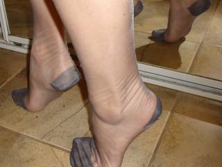 Lisa\'s sexy legs and feet in grey stockings.