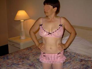 My wife posing in pink lingerie.