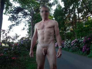 Showing off on a pubic road. Do you like the flowers.